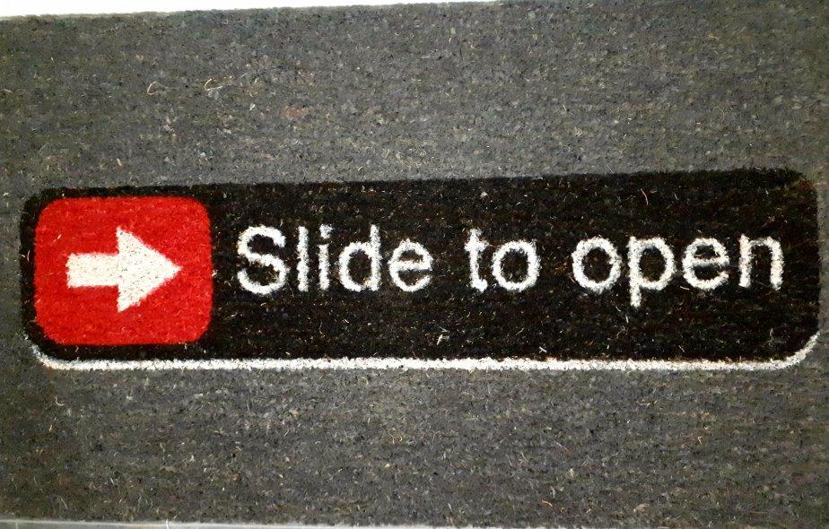 Slide to Open Doormat